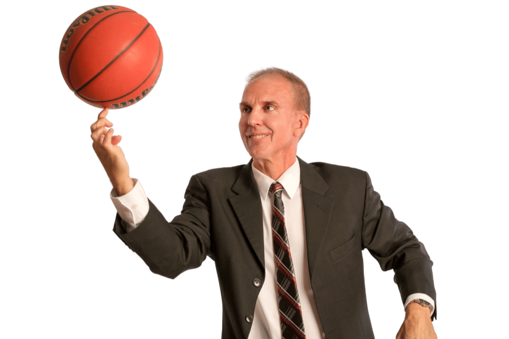 Coach Jim Johnson Spinning Basketball in Suit